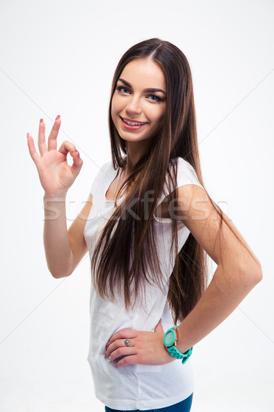 Smiling woman standing with arms folded  Stock photo © deandrobot