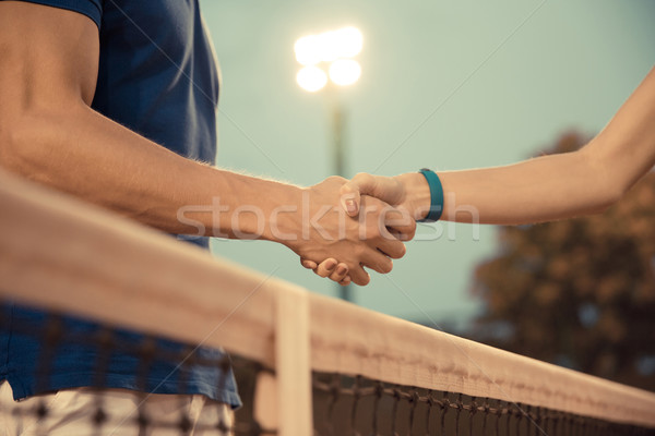 Man and woman handshaking  Stock photo © deandrobot