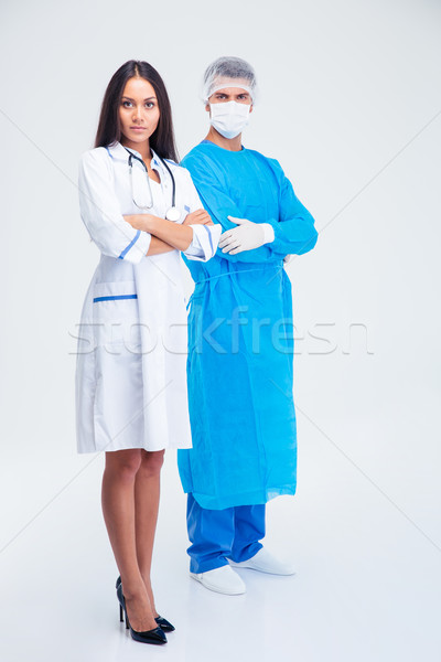 Full length portrait of a two medical workers  Stock photo © deandrobot