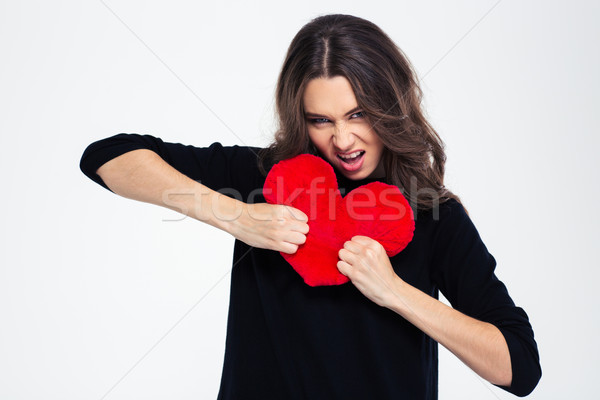 Portrait of a young girl breaking heart Stock photo © deandrobot