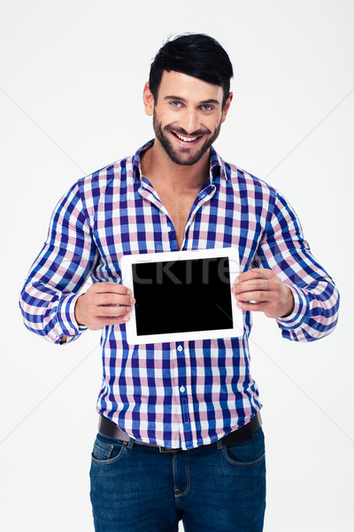 Stock photo: Portrait of a smiling man showing tablet computer screen