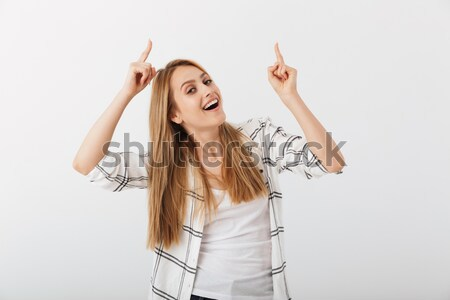 Portrait of a woman yawning Stock photo © deandrobot