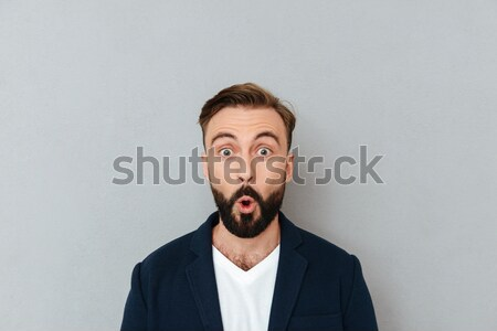 Portrait of overworked tired young man Stock photo © deandrobot