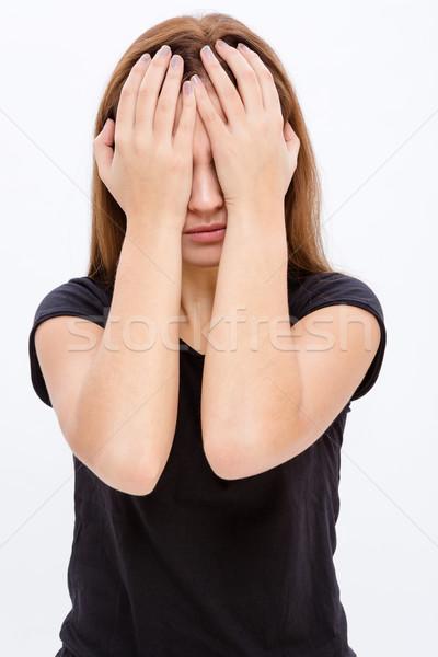 Umutsuz genç kadın kapalı gözler eller Stok fotoğraf © deandrobot