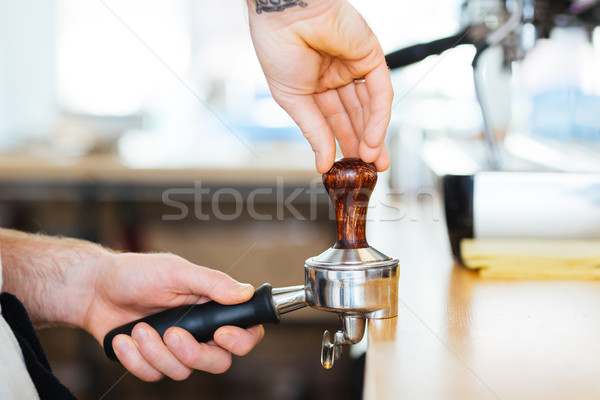 Closeup of portafilter with temper used by barista hands Stock photo © deandrobot