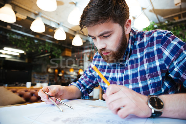 Man engineer working on blueprint Stock photo © deandrobot