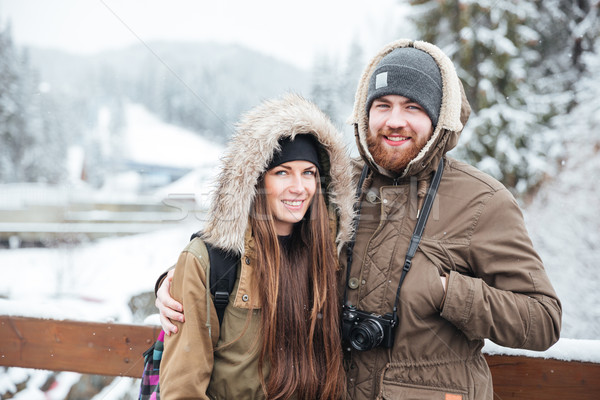 Couple with photo camera on winter mountain resort Stock photo © deandrobot