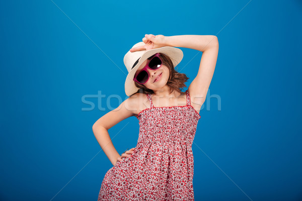 Charming smiling little girl in  sunglasses  showing peace sign Stock photo © deandrobot
