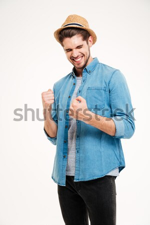 Casual handsome man in hat rejoices isolated Stock photo © deandrobot