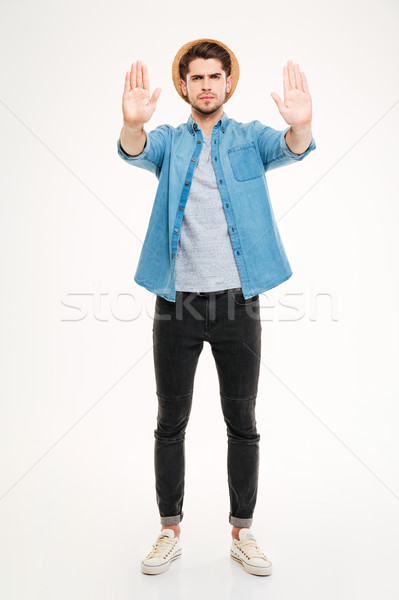 Full length of angry man standing and showing stop gesture Stock photo © deandrobot