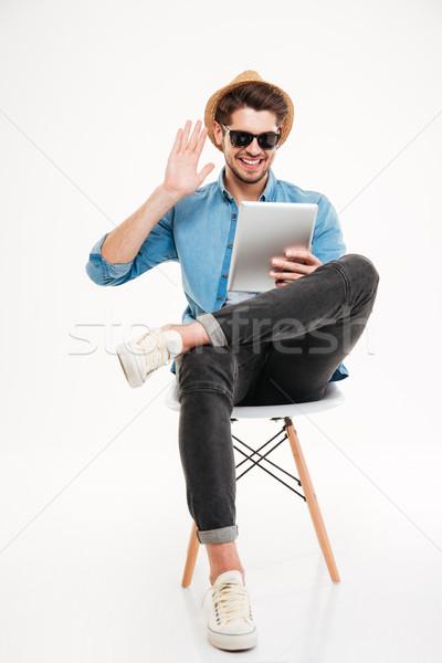 Man vergadering stoel praten glimlachend Stockfoto © deandrobot