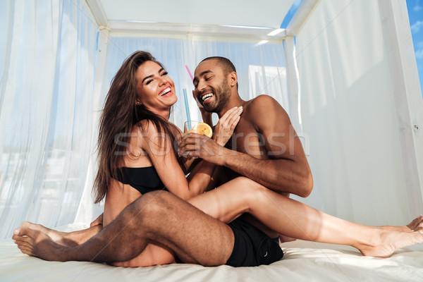 Young beautiful multiracial couple having fun at the beach Stock photo © deandrobot