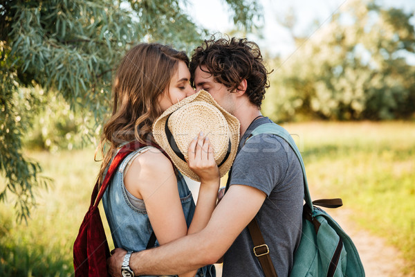 Couple in love kissing with their eyes closed in forest Stock photo © deandrobot