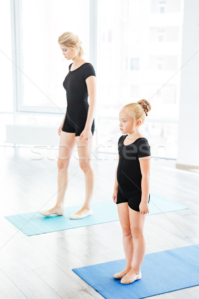 Stock photo: Mother teaching daughter ballet at the studio