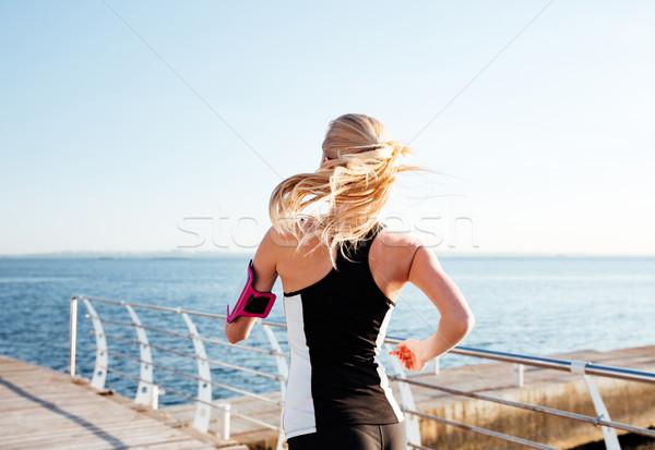 背面図 若い女性 行使 海 桟橋 小さな ストックフォト © deandrobot