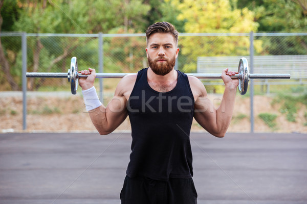 Muskularny fitness przystojny mężczyzna treningu sztanga brodaty Zdjęcia stock © deandrobot
