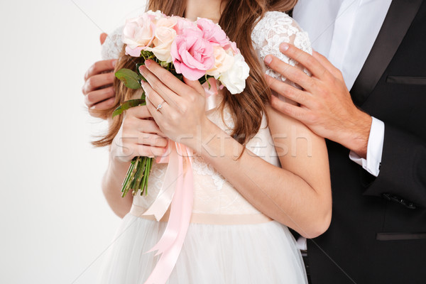 Cropped photo of couple with bouqute Stock photo © deandrobot