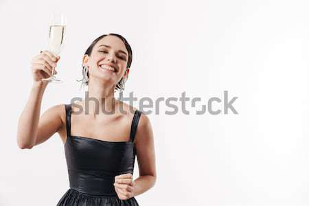 Happy smiling fitness woman waving at her mobile phone Stock photo © deandrobot