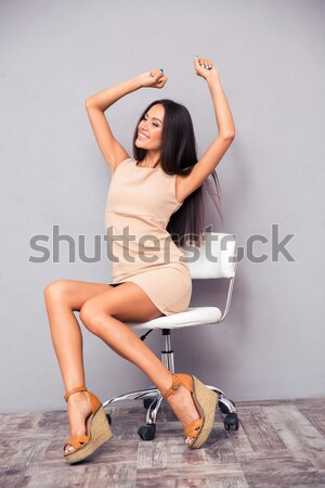 Woman in lingerie and stockings sitting on a chair Stock photo © deandrobot