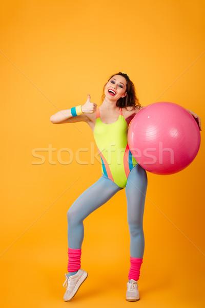 Boldog sportok nő citromsárga fitnessz kép Stock fotó © deandrobot