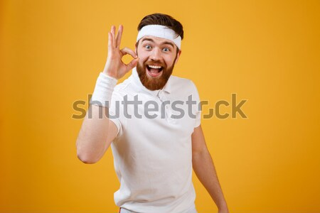 Screaming happy sportsman in sunglasses looking camera Stock photo © deandrobot