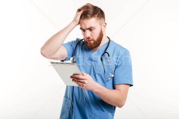 портрет удивленный молодые врач синий равномерный Сток-фото © deandrobot