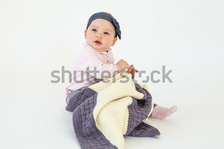 Happy girl sitting on floor with plaid Stock photo © deandrobot