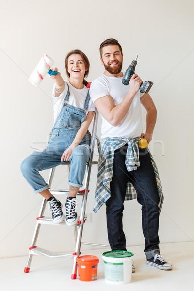Boldog pár mutat szerszámok javítás áll Stock fotó © deandrobot