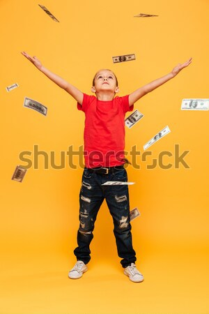 Portrait of a pretty young girl embracing herself while standing Stock photo © deandrobot