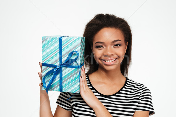 Feliz bastante África muchacha adolescente presente Foto stock © deandrobot
