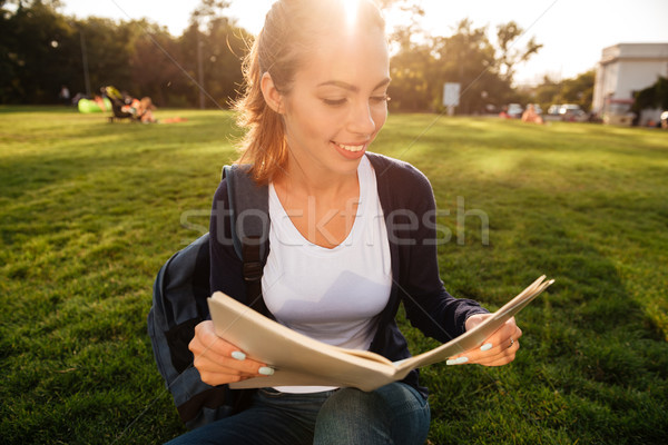 Close up portrait of a casual student girl with backpack Stock photo © deandrobot