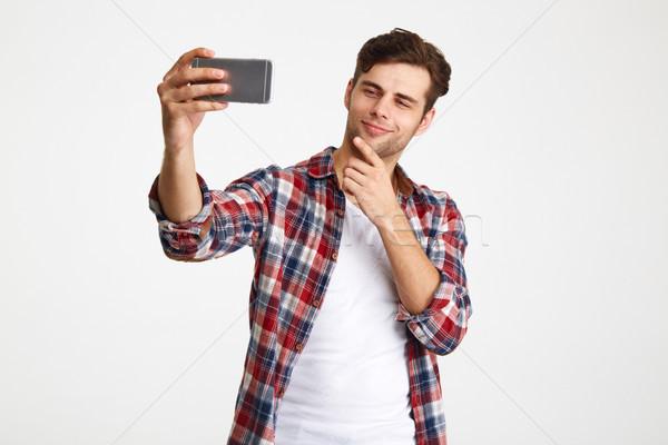 Porträt zufrieden Mann Aufnahme stehen Stock foto © deandrobot