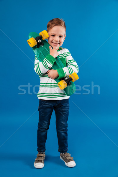 Immagine sorridere skateboard Foto d'archivio © deandrobot