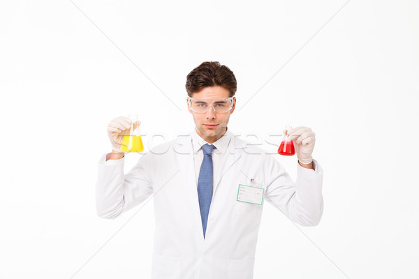 Portrait of a concentrated young male scientist Stock photo © deandrobot