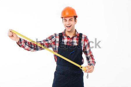 Portrait of a smiling young male builder Stock photo © deandrobot