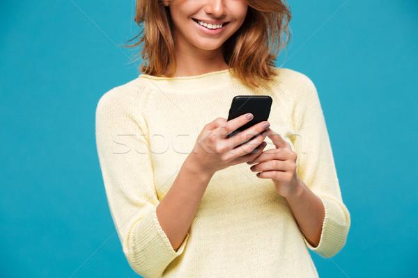 Image incroyable jeune femme téléphone sourire Photo stock © deandrobot