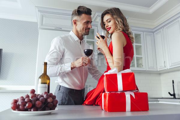 Portrait of a beautiful romantic smart dressed couple Stock photo © deandrobot