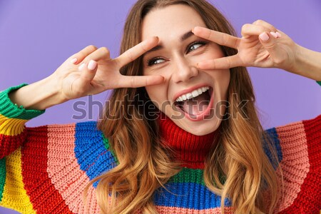 Portrait of a surprised brown haired woman Stock photo © deandrobot