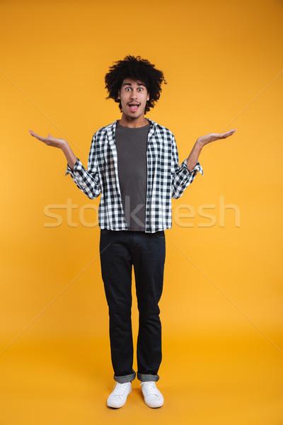 Tam uzunlukta portre heyecanlı genç Afrika adam Stok fotoğraf © deandrobot