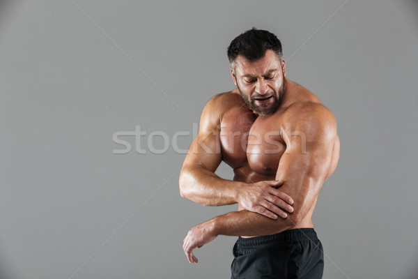 Portrait of a muscular male bodybuilder Stock photo © deandrobot