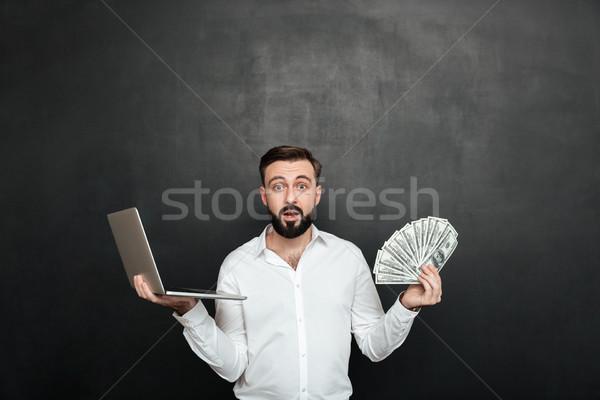 Retrato surpreendido adulto cara branco camisas Foto stock © deandrobot