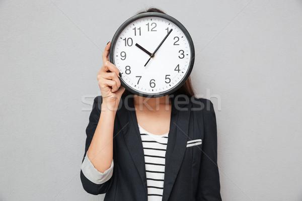 Görüntü Asya iş kadını gizleme arkasında saat Stok fotoğraf © deandrobot