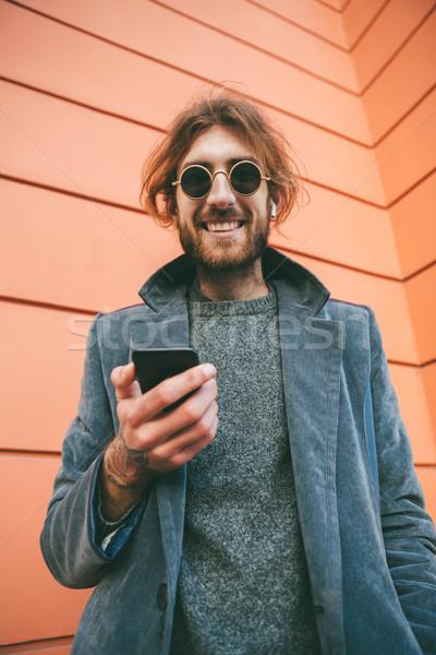 肖像 笑みを浮かべて あごひげを生やした 男 コート 立って ストックフォト © deandrobot