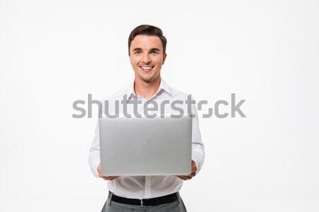 Portré elégedett mosolyog fickó dolgozik laptop számítógép Stock fotó © deandrobot