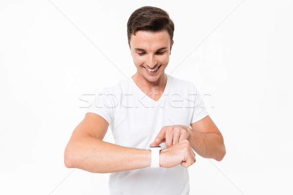 Portrait of a handsome modern man using smart watch Stock photo © deandrobot
