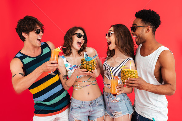 Group of happy young multiracial friends in summer clothes Stock photo © deandrobot