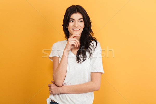 Happy young pretty woman looking aside. Stock photo © deandrobot