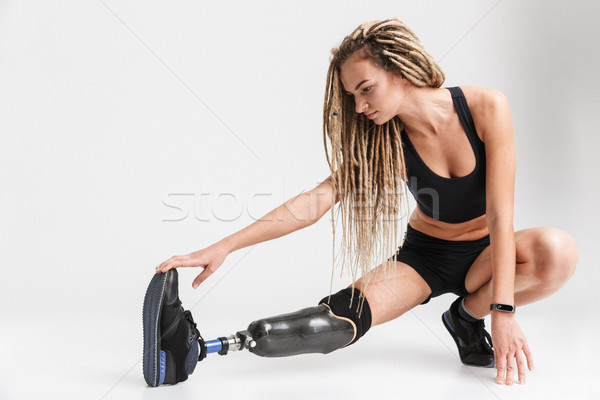 Amazing healthy young disabled sportswoman make exercises. Stock photo © deandrobot