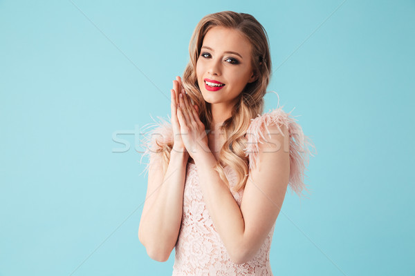 Sensual blonde woman in dress posing with arms near face Stock photo © deandrobot