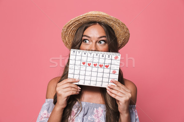 Portrait of young excited woman 20s wearing straw hat holding me Stock photo © deandrobot